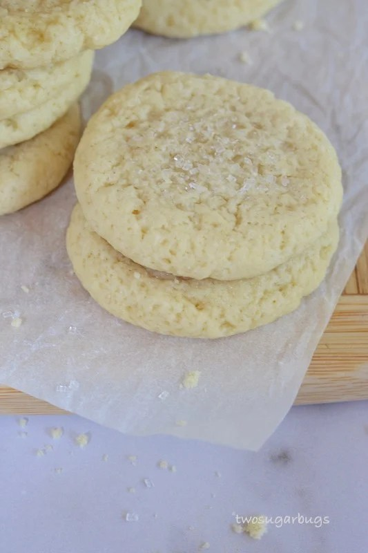 Two easy and soft drop sugar cookies on a cutting board