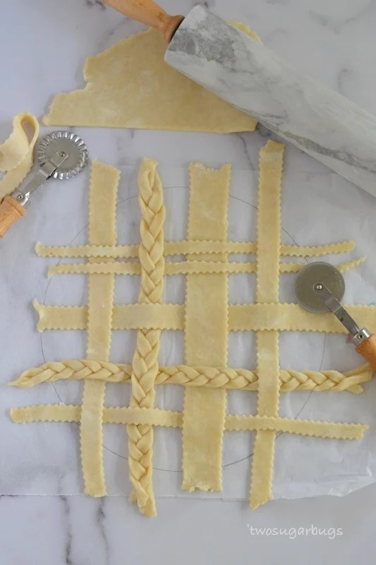 Lattice pie topping laid out on parchment paper