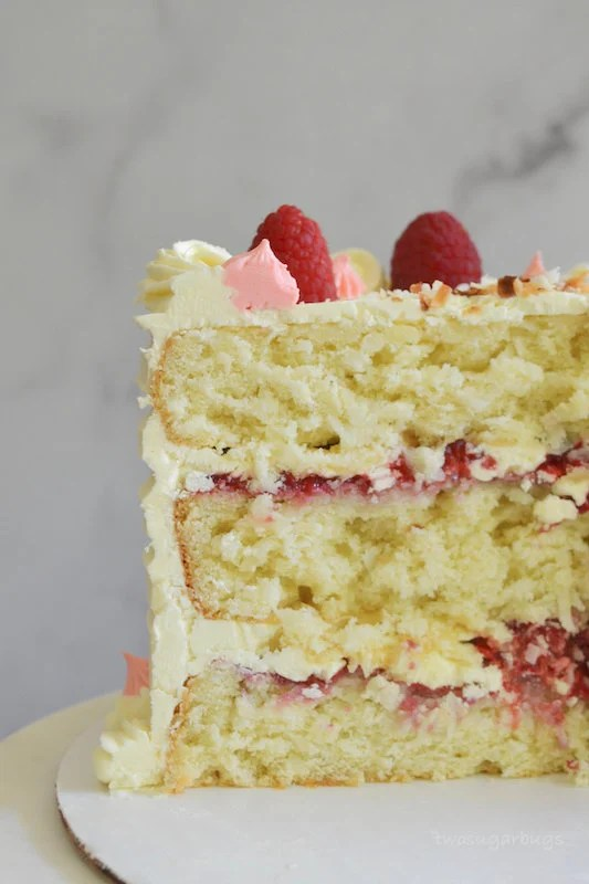 Inside shot of perfect coconut cake with raspberries