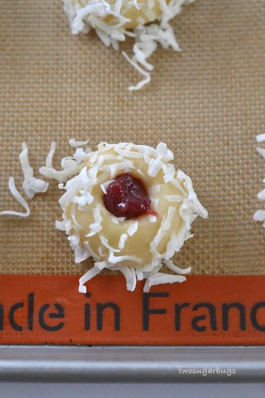 Overhead shot of an unbaked coconut jam thumbprint