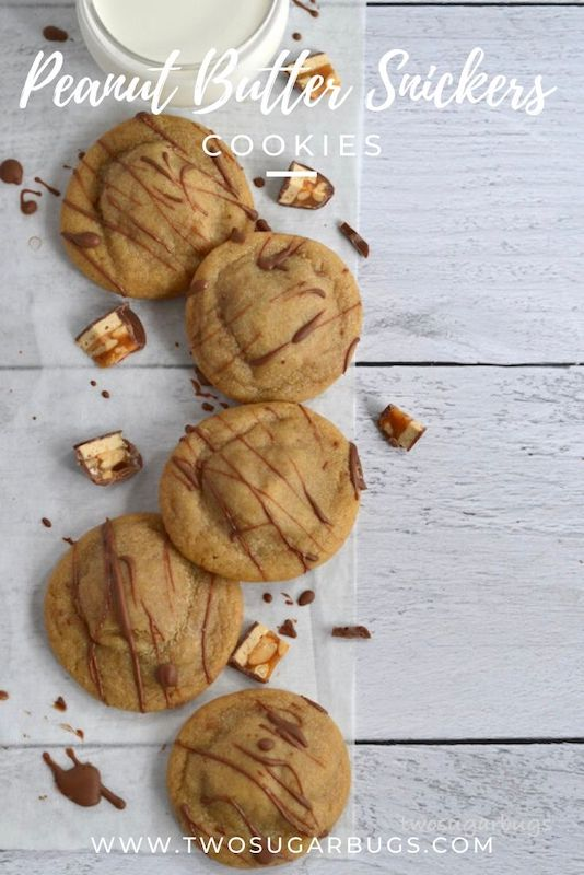 Peanut Butter Snickers Cookies {Santa Surprises} ~ A soft and chewy peanut butter cookie stuffed with a Snickers miniature and drizzled in chocolate!  Perfect for holiday cookie platters or anytime that peanut butter and chocolate craving hits! ~ #peanutbutter #snickers #holidaycookies #peanutbutterchocolate #twosugarbugs