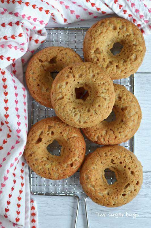unglazed donuts on a cooling rack