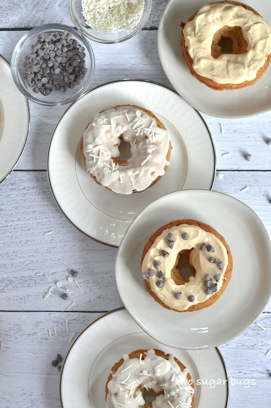 four plates with donuts glazed two ways