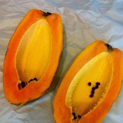 Enjoying minimal seeds in a beautiful papaya!
