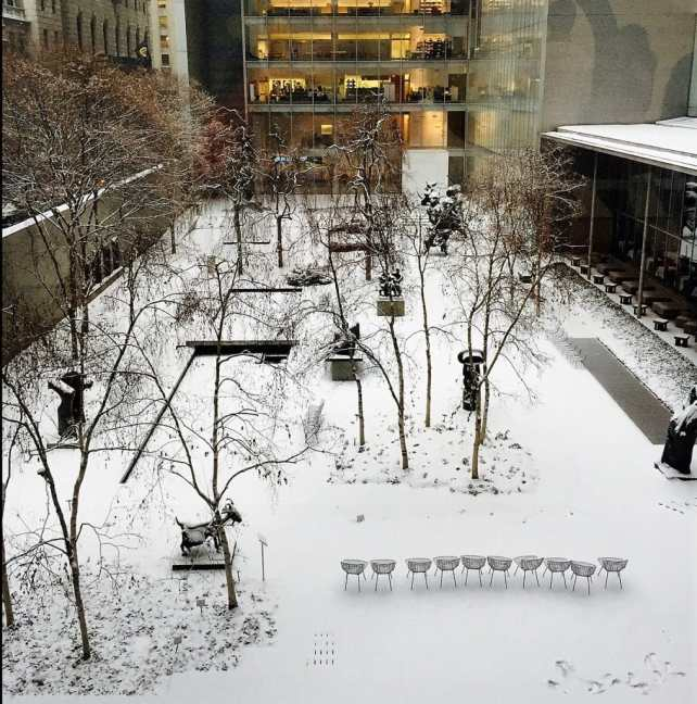 "The MOMA sculpture garden covered in snow! - ""Met vs MOMA: Which Museum is Best?"" - Two Traveling Texans"