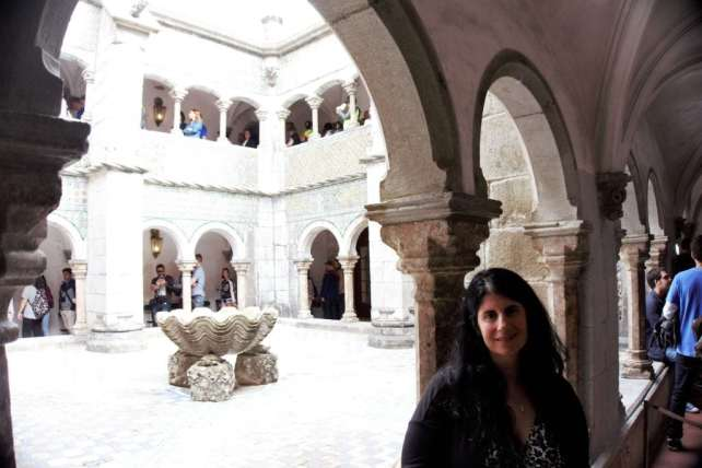 """Anisa inside the courtyard of Pena Palace. - """"Pena Palace: Sintra's Fairytale Castle"""" - Two Traveling Texans"""