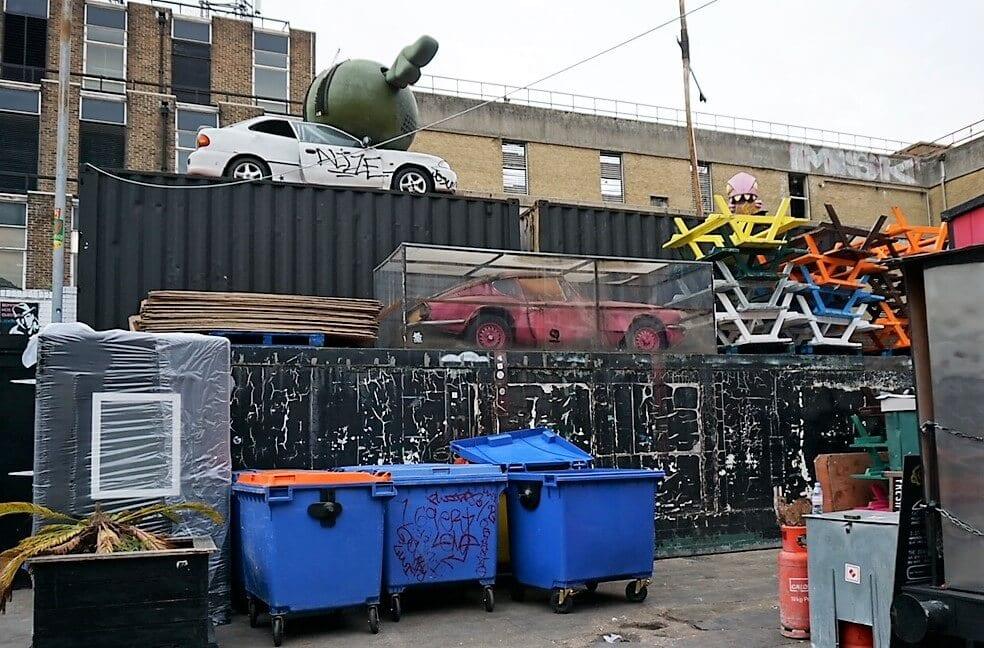 "Banksy's Pink Car is kept under plexiglass. ""Free Shoreditch Street Art Tour"" - Two Traveling Texans"