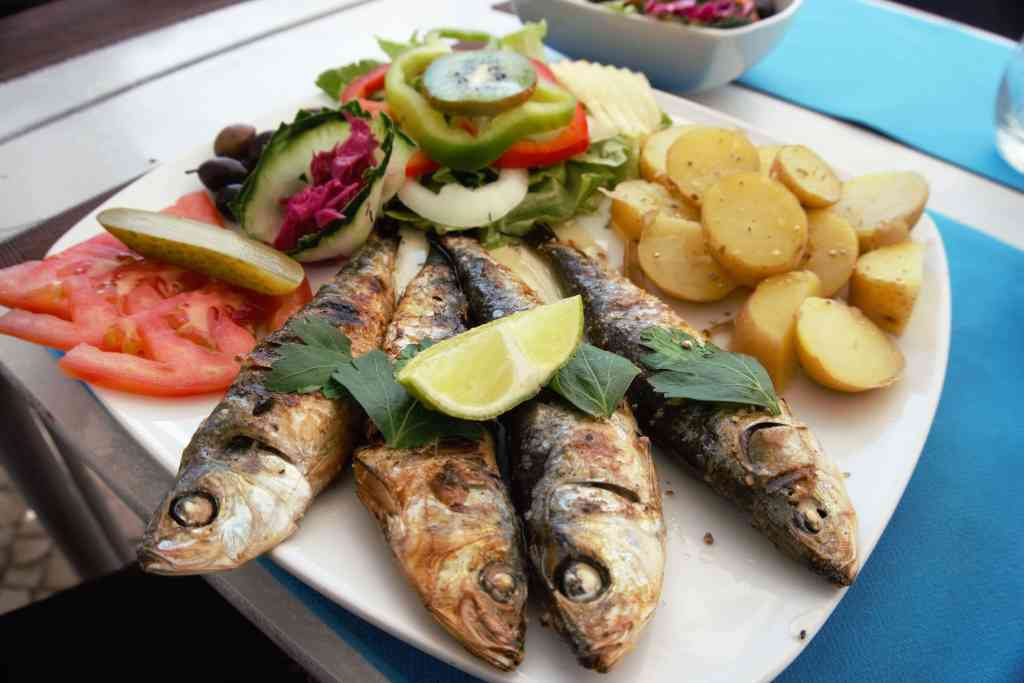 """The food in Portugal (and especially the Algarve) was delicious! I really love the sardines.- """"Our Amazing Portugal Road Trip Itinerary"""" - Two Traveling Texans"""