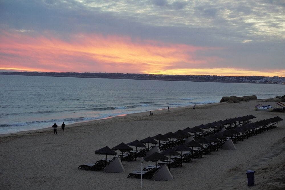 """Watching the sunset over dinner was a great way to spend our last night in Portugal. - """"Our Amazing Portugal Road Trip Itinerary"""" - Two Traveling Texans"""