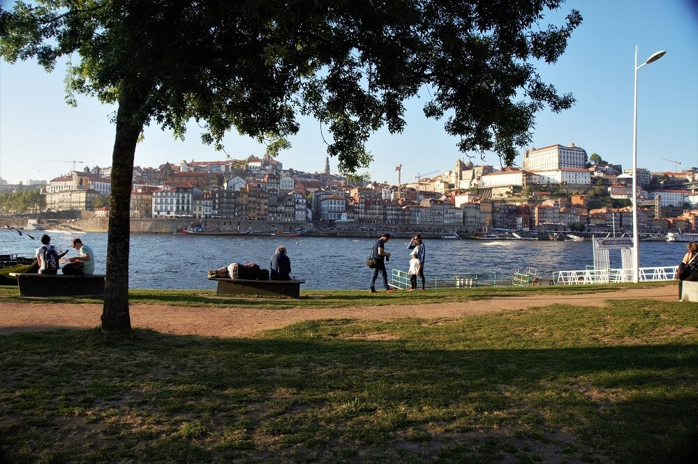 """Hanging out along the Douro River in Porto- """"Our Amazing Portugal Road Trip Itinerary"""" - Two Traveling Texans"""