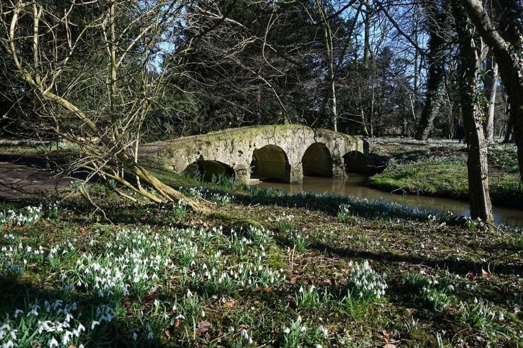 """This beautiful bridge is made from stones from Walsingham Abbey. - """"Walsingham Pilgrimage and Snowdrops"""" - Two Traveling Texans"""