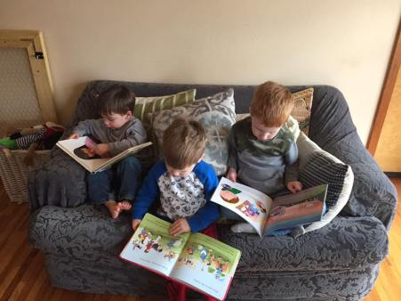 Children reading to themselves during quiet time.