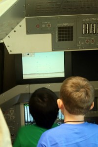 New Mexico Museum of Space History: trying to land the spaceship.