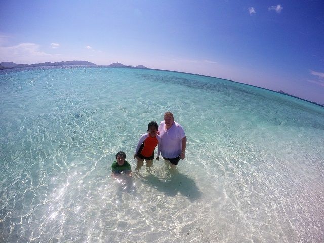 Two Worlds Treasures - us at White Sandy Beach in Labuan Bajo, Flores, Indonesia.