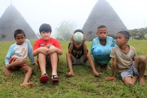 Two Worlds Treasures - my son with the village boys, Wae Rebo, East Nusa Tenggara, Indonesia.