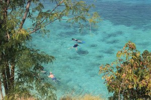 Island Hopping Flores, Indonesia - Day 1 - people snorkeling at Kelor - Two Worlds Treasures