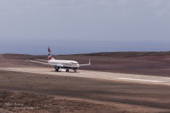 Touchdown. A Historic Moment for St Helena as flight MN8427 Boeing 737-800 touches down on the runway.