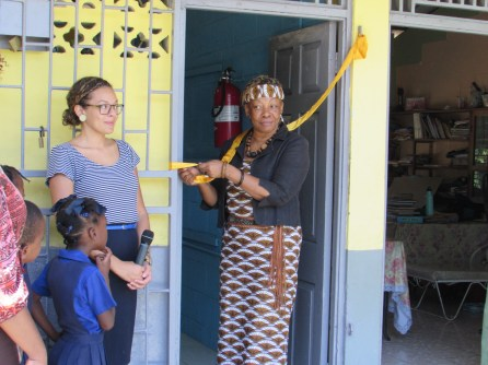 """Auntie Amina getting ready to """"cut"""" the ribbon"""