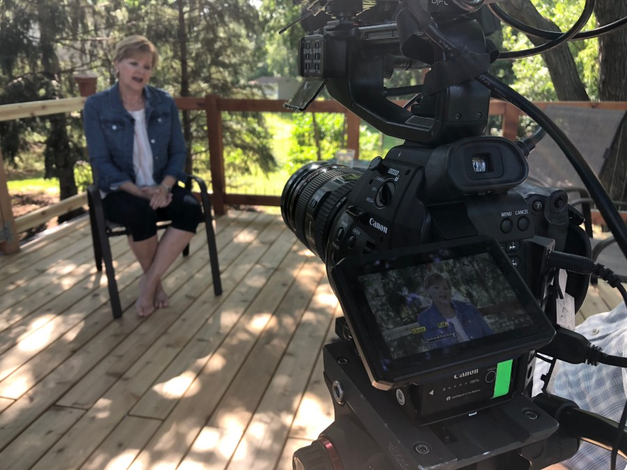 a digital cinema camera films an interview subject