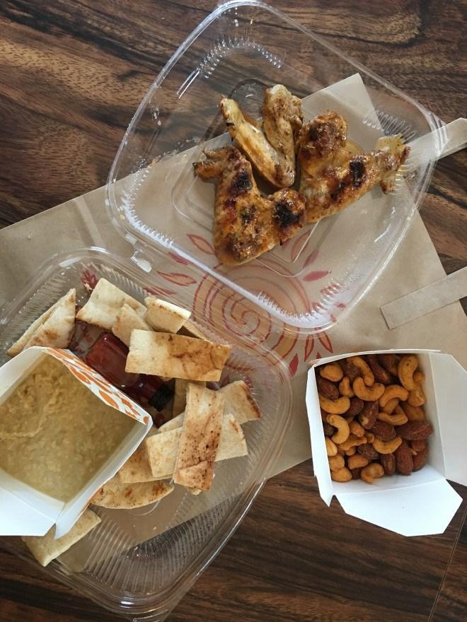 Top: Hot chicken wings Bottom R: PERi-PERi nuts Bottom L: Hummus with pita bread