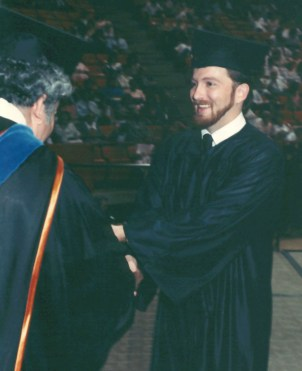 Graduating with a BA from UNT 08/13/1988