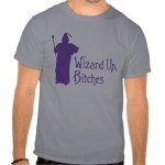 "Male Model wearing a t-shirt with a weird, wacky and wonderful the design shows a wizard silhouette captioned ""Wizard up Bitches"" combines the modern and the medieval wildly mixing memes"
