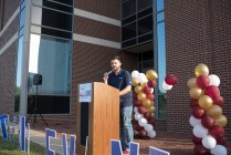 Michael Stephenson pumps up the crowd of participants outside TAMU-T's STEM building. (Photo by Erin Rogers | TXK Today)