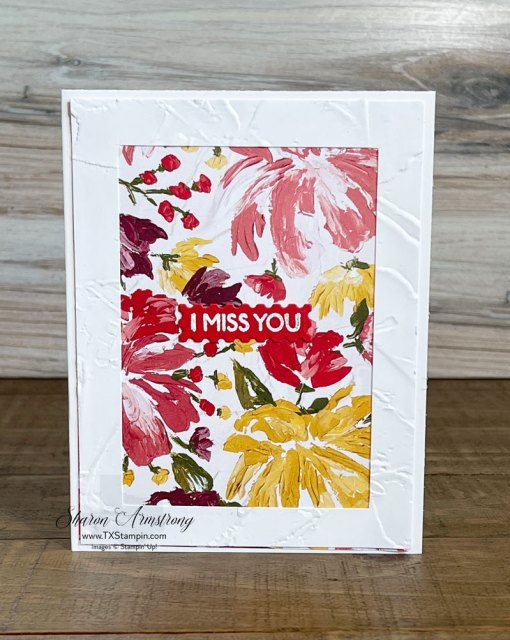 Beautiful card with scrapbook paper as the focal point and framed by embossed cardstock.