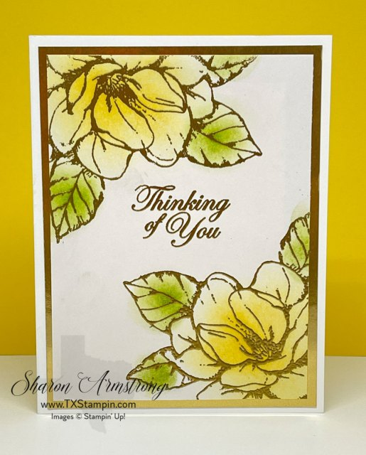 This handmade thinking of you card features gold embossing powder and blended inks on the magnolia blooms and leaves.