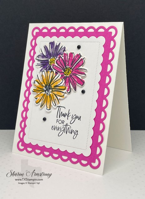 This handmade thank you card features the die cut flowers stamped in bright pinks, yellows & purples.