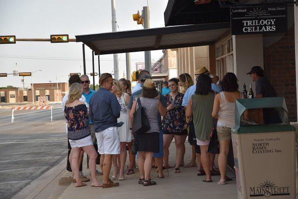Group on sidewalk tasting