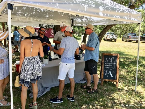 Mike Nelson, winemaker, and Mitchell Sharrock serving Ab Astris Winery wines