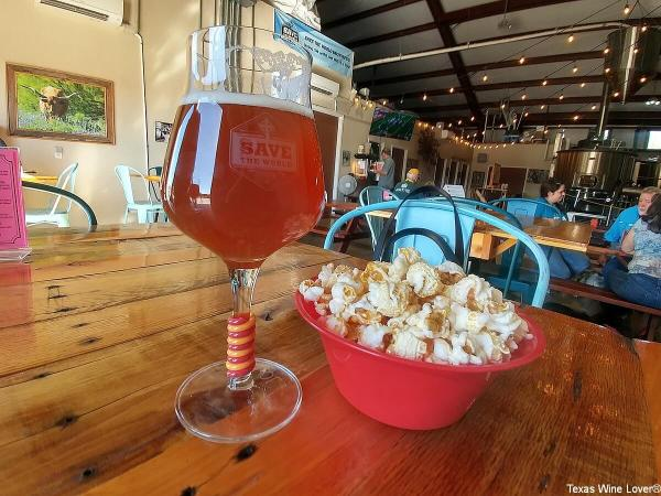 Save the World beer and popcorn