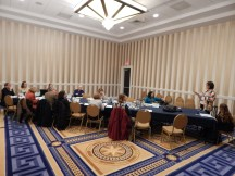 TYCA Executive Board Meeting in Washington, DC, November 2014. far left, behind table to front of table: Andy Anderson (Chair), Eva Payne (Associate Chair). Sarah Z. Johnson (Secretary), Jeff Sommers (TETCY Editor), Judy Angona (Northeast), Sravani Banerjee (Pacific Coast/ECCTYC), Joyce Locke Carter (CCCC), Linda Walters-Moore (TYCA Administrative Liaison), Suzanne Labadie (Midwest), Alexis Nelson (Pacific Northwest), Cheryl Hogue Smith (Incoming Secretary), David Lydic (Southwest), and Beverly Fatheree (Southeast)