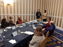 TYCA Executive Board Meeting in Washington, DC, November 2014. Andy Anderson (Chair) passes the chair to Eva Payne (Associate Chair) as Cheryl Hogue Smith (Incoming Secretary), David Lydic (Southwest), Beverly Fatheree (Southeast), Sarah Z. Johnson (Secretary), Jeff Sommers (TETYC Editor), and Judy Angona (Northeast) look on