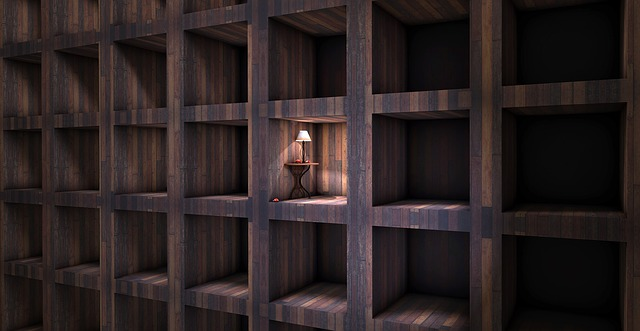 Grid of niches in a wall with a table and lamp in one of them