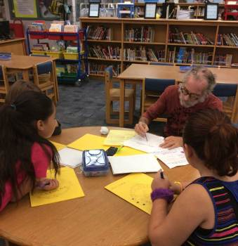 Steve Novy, teaching artist, with students