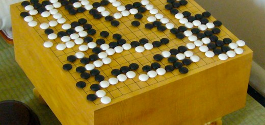 A game of Go in progress on a traditional Goban.