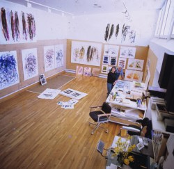 Joan Mitchell and Kenneth Tyler surrounded by numerous prints by Mitchell