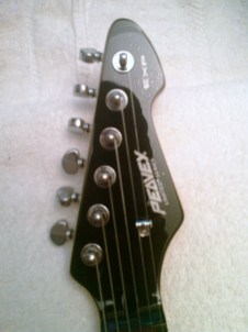 Piano black headstock & back