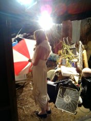 Laura playing with an umbrella for a montage sequence