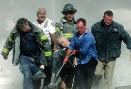 Father Judge being carried away from the South Tower