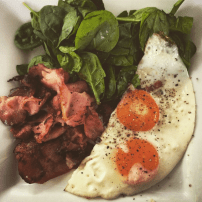 Spinach, fried eggs and bacon