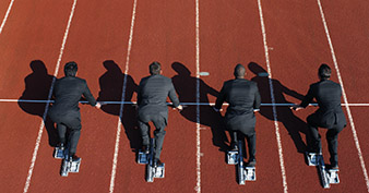 high angle view of a group of businessmen ready to run a race