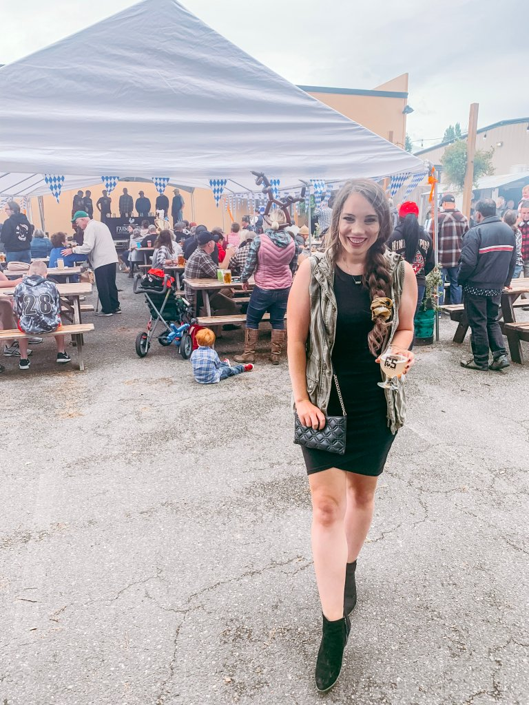 fall transitional outfit bodycon dress with utility vest at oktoberfest