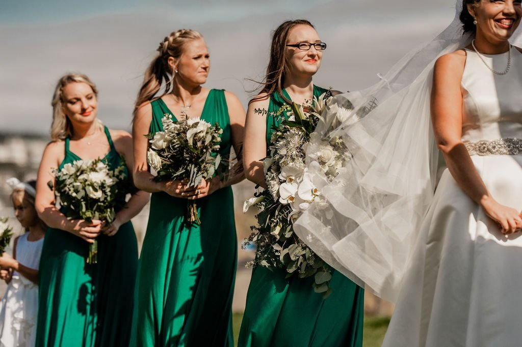 bride and bridesmaids outdoor beach wedding