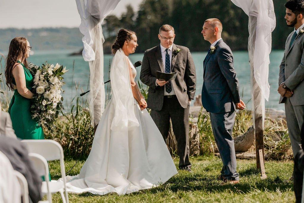 outdoor beach island wedding ceremony bride groom maid of honor best man