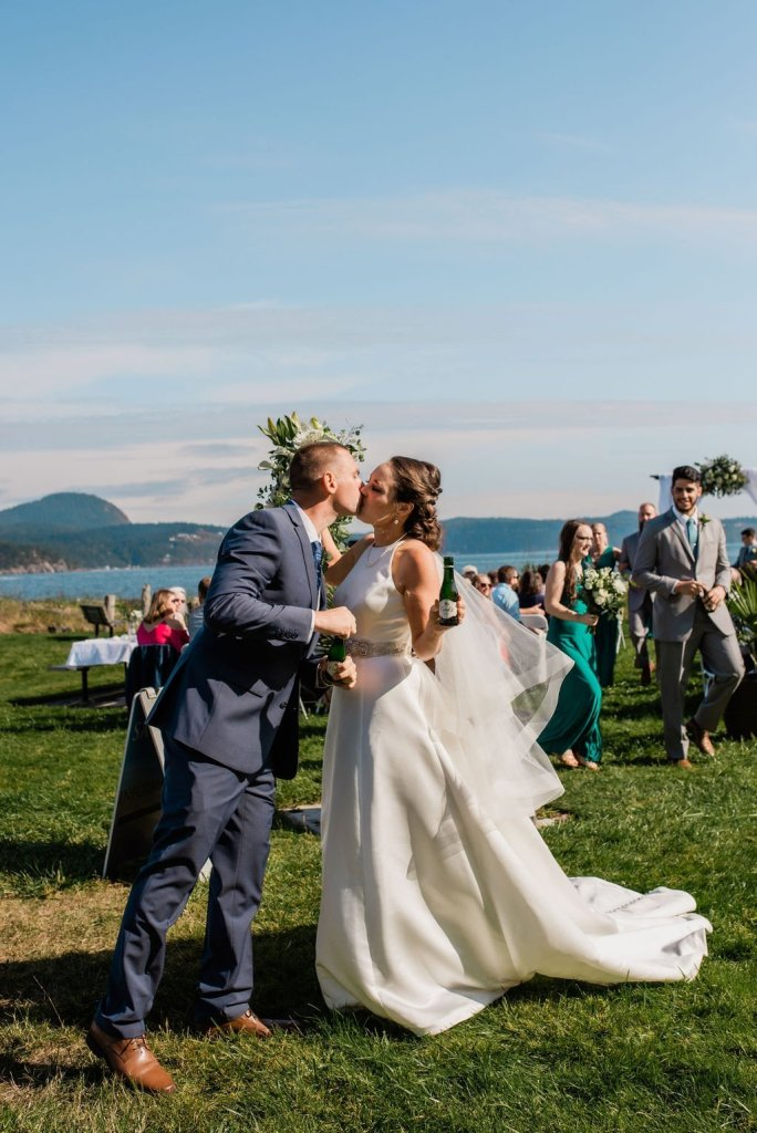 first kiss bride and groom after Pacific Northwest outdoor wedding ceremony Seattle