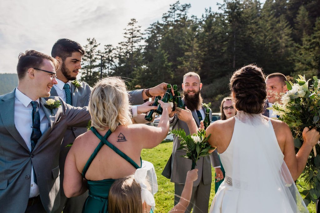 bridal party cheers after Pacific Northwest wedding ceremony seattle