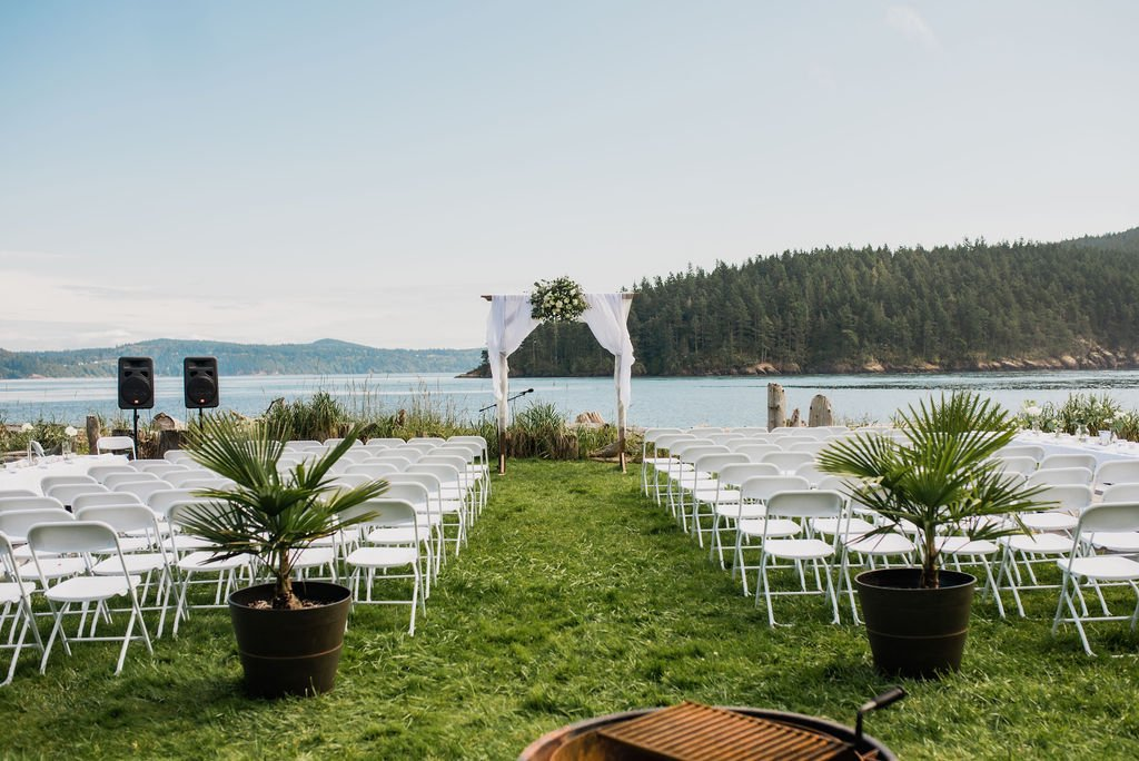 skyline cabana, Washington wedding venues, Anacortes wedding, Skagit wedding, Washington wedding, outdoor beach wedding venue, Pacific Northwest wedding venue, beach wedding ideas, summer beach wedding, palm trees, wedding arch, wood arch, fabric covered wedding arch